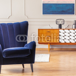 Close-up of a dark blue armchair...
